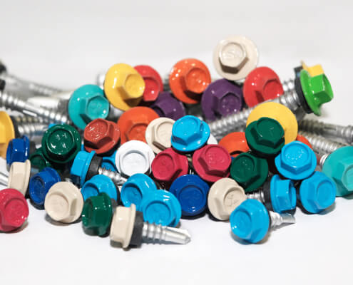 Pile of BDN Fastener self tapping metal stud screws with multi-colored head marks